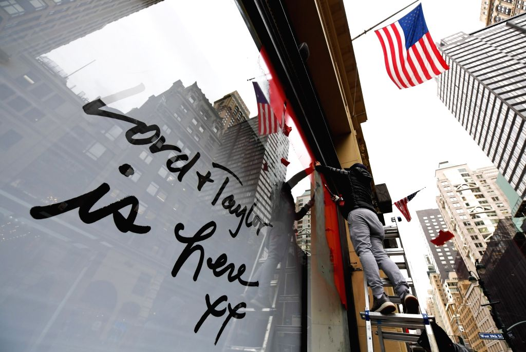 NEW YORK, Jan. 3, 2019 - A worker cleans up window posters at the flagship store of the famous department store chain Lord & Taylor on Fifth avenue in Manhattan, New York, the United States, Jan. ...