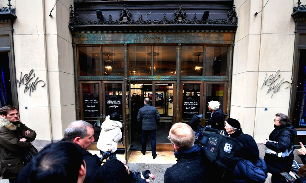 NEW YORK, Jan. 3, 2019 - Journalists gather at the gate of the flagship store of the famous department store chain Lord & Taylor on Fifth avenue in Manhattan, New York, the United States, Jan. 2, ...