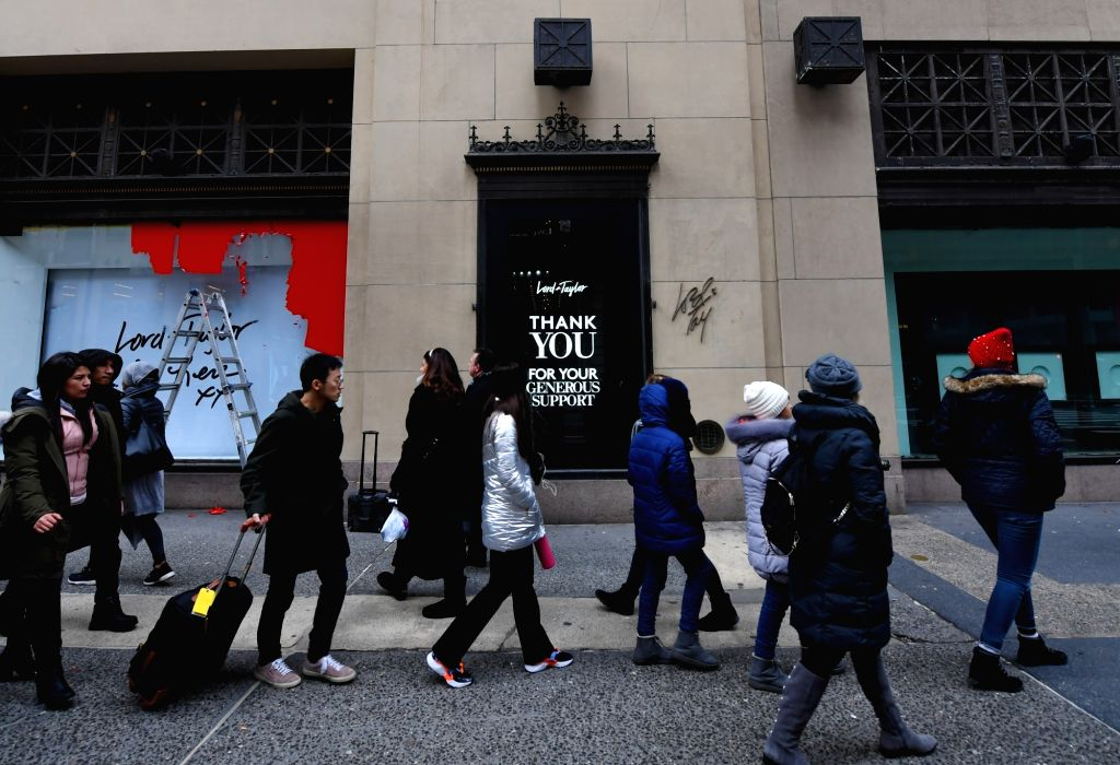 NEW YORK, Jan. 3, 2019 - People walk past the shop window of the flagship store of the famous department store chain Lord & Taylor on Fifth avenue in Manhattan, New York, the United States, Jan. ...