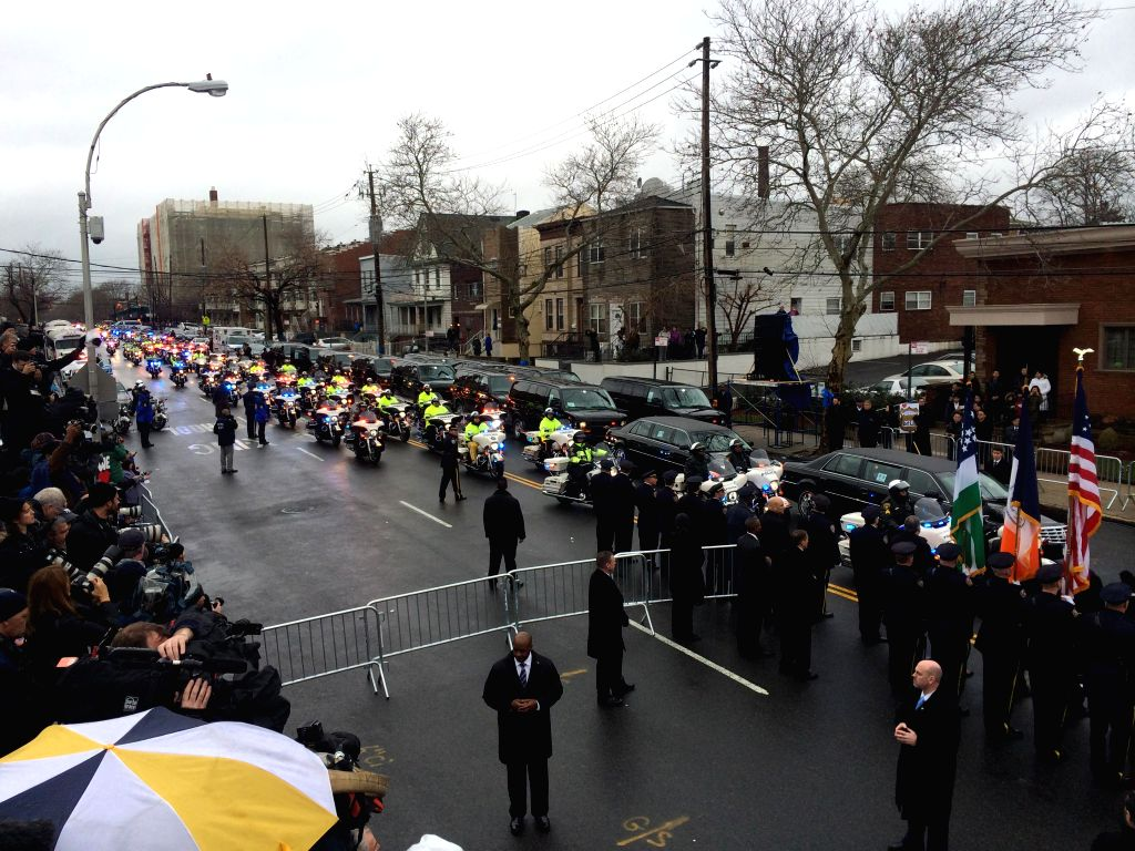Police officers attend the funeral of slain New York Police Department officer Wenjian Liu in Brooklyn of New York City, the United States, Jan. 4, 2015. Liu and ...