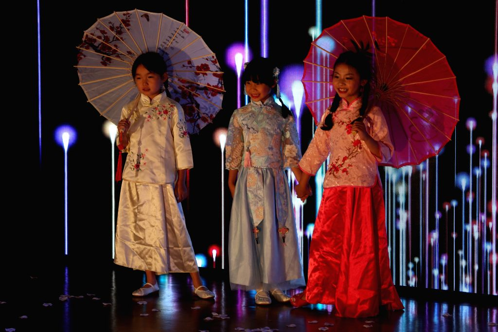 NEW YORK, July 15, 2019 - Children present Chinese traditional dresses during the 2019 Miss China International Contest (North America) in New York, the United States, on July 14, 2019. The 2019 Miss ...