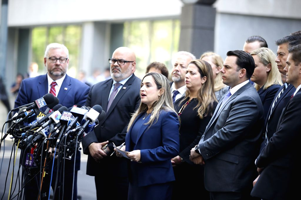 NEW YORK, July 17, 2019 - Ariana Fajardo Orshan (C), the United States Attorney for the Southern District of Florida, makes a statement outside a federal court in New York City's Brooklyn borough, ...