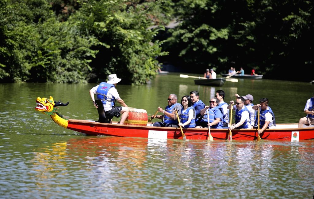 NEW YORK, July 18, 2018 - Invited guests row a dragon boat prior to a traditional dragon boat awakening ceremony for the 28th annual Hong Kong Dragon Boat Festival in New York, the United States, on ...