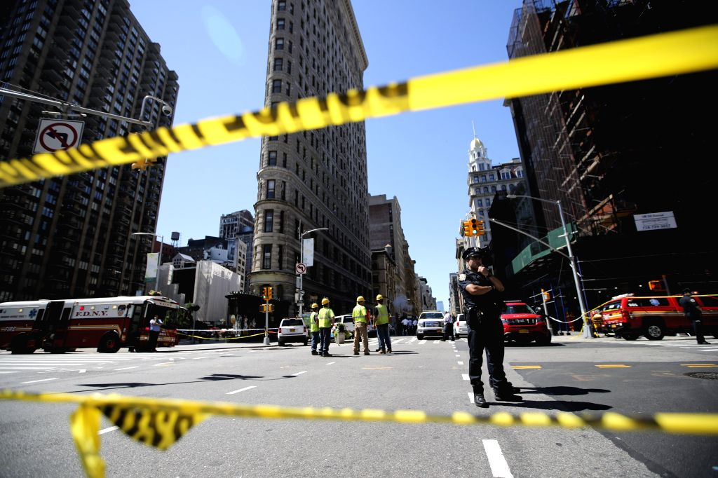 NEW YORK, July 19, 2018 - Police stand guard near the spot of a steam pipe explosion in New York, the United States, July 19, 2018. A neighborhood in Manhattan, New York City, was rocked Thursday ...