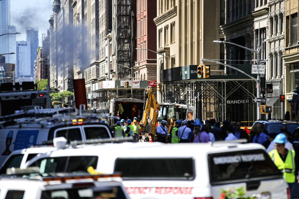 NEW YORK, July 19, 2018 - Workers and vehicles are seen at the spot of a steam pipe explosion in New York, the United States, July 19, 2018. A neighborhood in Manhattan, New York City, was rocked ...