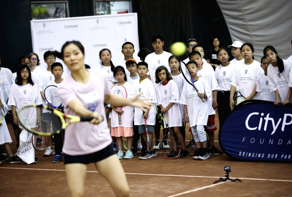 NEW YORK, July 19, 2019 - Two-time Grand Slam Champion Chinese tennis player Li Na (front) shows skills to young tennis players during a youth tennis clinic in Mahattan of New York, the United ...