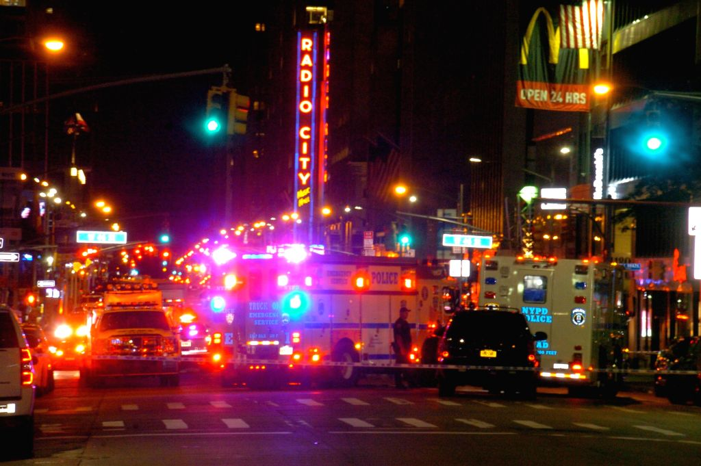 NEW YORK, July 21, 2016 - Police trucks are seen in the midtown of Manhattan, New York, the United States, July 20, 2016. A man tossed a hoax explosive into a marked police car in midtown Manhattan ...