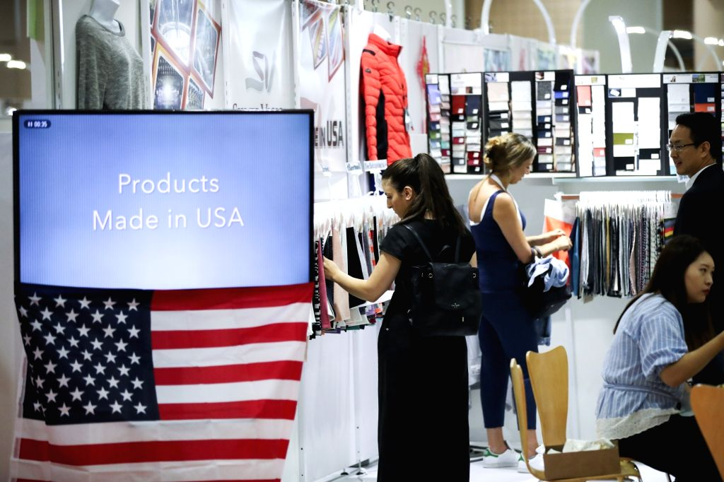 NEW YORK, July 24, 2018 - Buyers look at exhibits of a U.S. producer at the Chinese Textile and Apparel Trade Show in New York, the United States, July 23, 2018. The 19th China Textile and Apparel ...