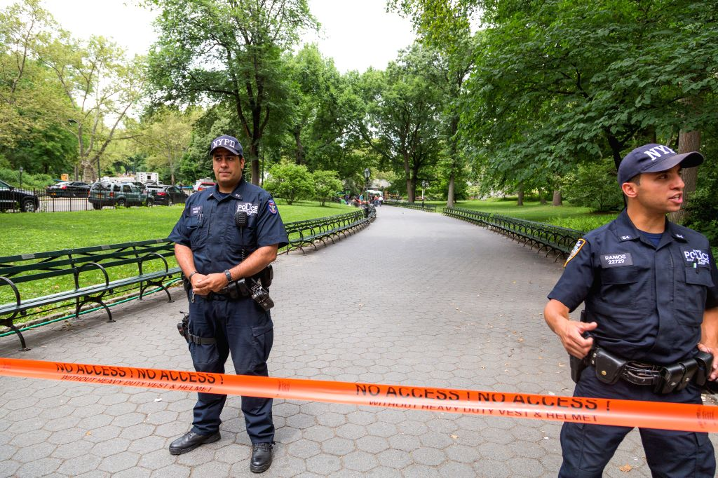 NEW YORK, July 4, 2016 - Police stand guard at Central Park in New York, the United States, on July 3, 2016. An explosion happened early on Sunday at New York's Central Park, leaving one man ...