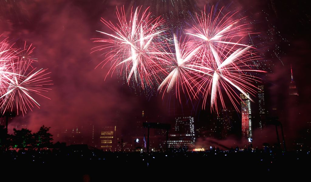 NEW YORK, July 5, 2016 - Fireworks are seen over the East River during the Macy's 4th of July Fireworks 2016 in New York, the United States, on July 4, 2016, marking the 240th anniversary of the ...