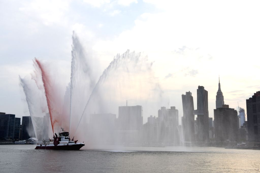NEW YORK, July 5, 2018 - A boat of the New York City Fire Department performs before the firework event to celebrate the Independence Day of the United States in New York July 4, 2018.