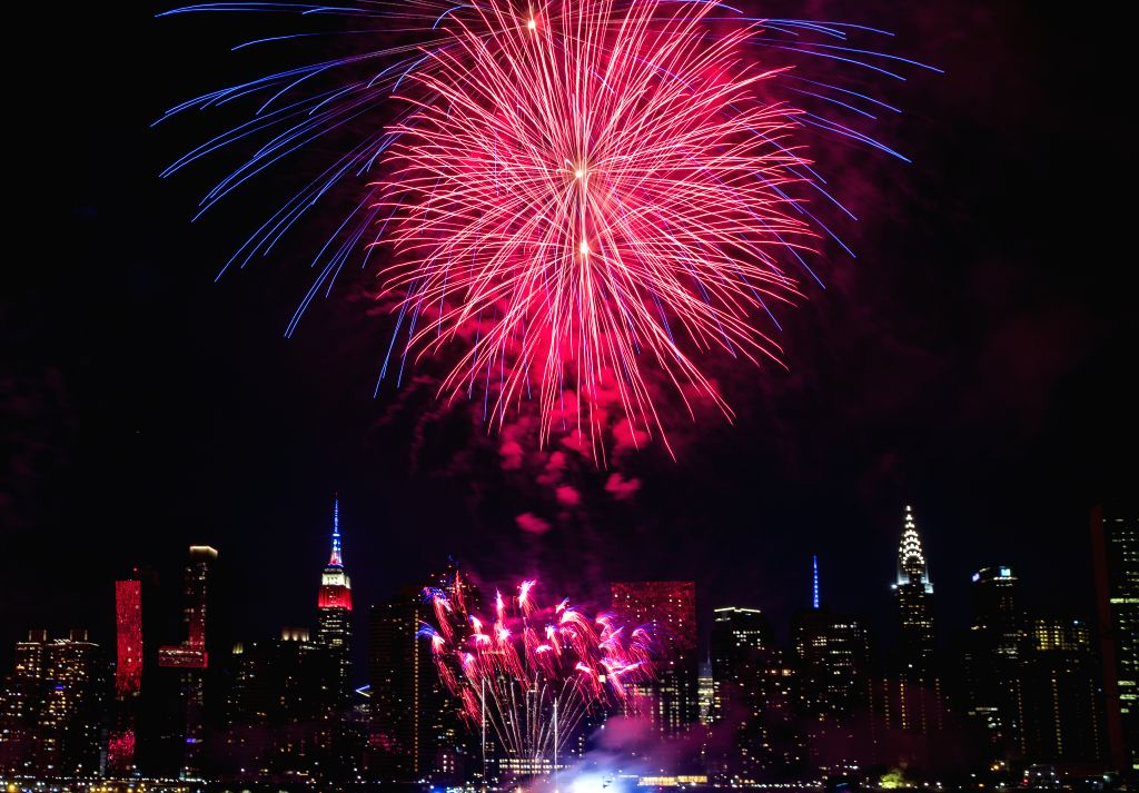 NEW YORK, July 5, 2018 - Fireworks explode over the East River to celebrate the Independence Day of the United States, in New York July 4, 2018.