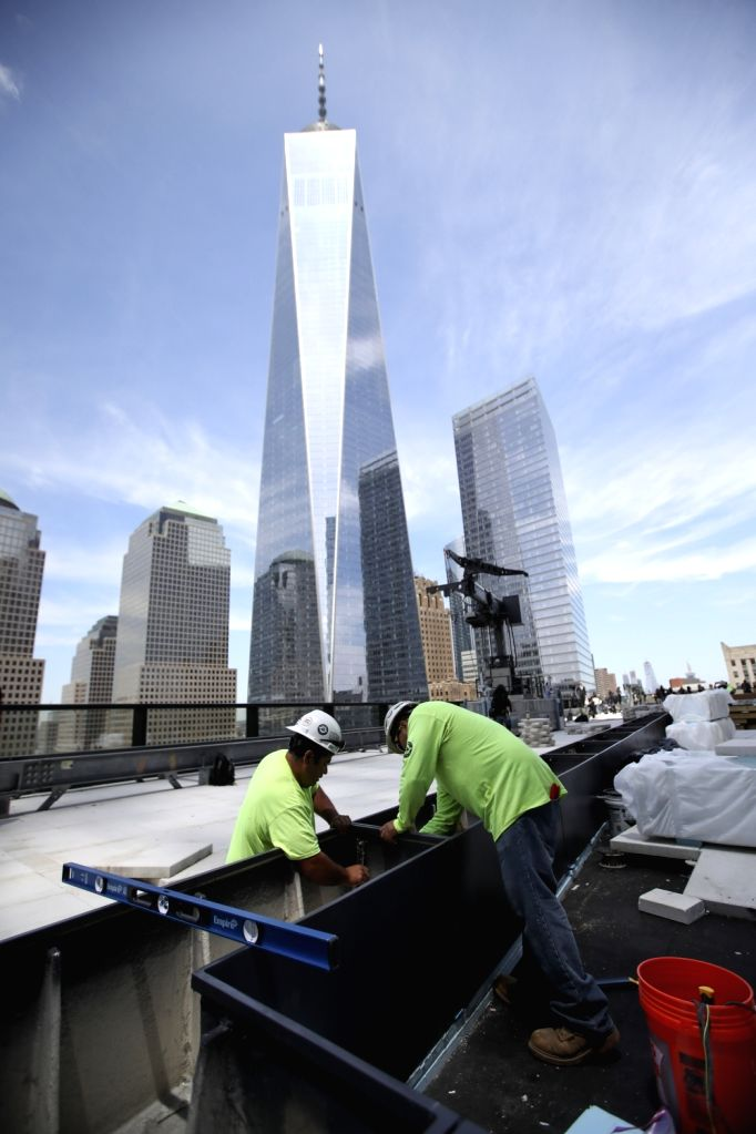 NEW YORK, June 11, 2018 - People work on the platform of 3 World Trade Center in lower Manhattan, New York, the United States, on June 11, 2018. The 80-story, 329-meter-high 3 World Trade Center was ...