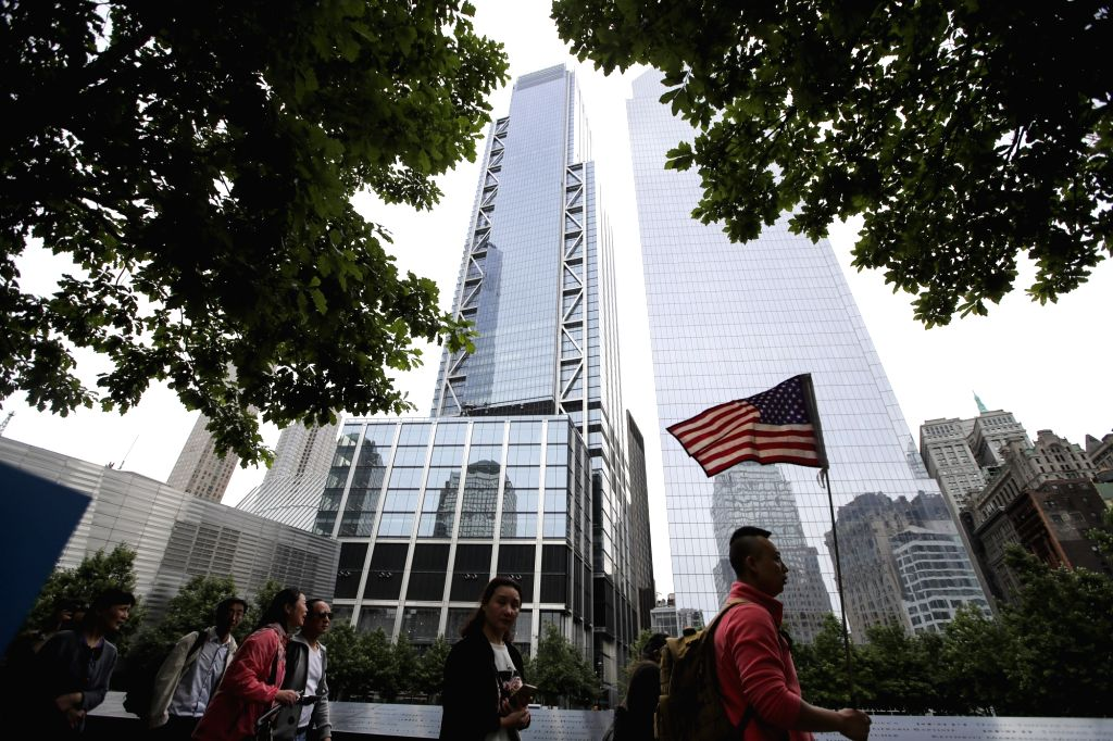 NEW YORK, June 11, 2018 - Tourists walk past 9/11 Memorial & Museum in front of 3 World Trade Center (L, Rear) in lower Manhattan, New York, the United States, on June 11, 2018. The 80-story, ...