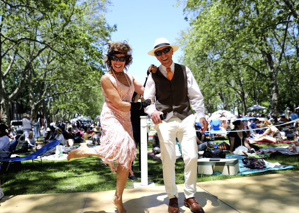 NEW YORK, June 15, 2019 - Participants dance during the 14th annual Jazz Age Lawn Party on Governors Island of New York, the United States, on June 15, 2019. The event which kicked off on Saturday ...