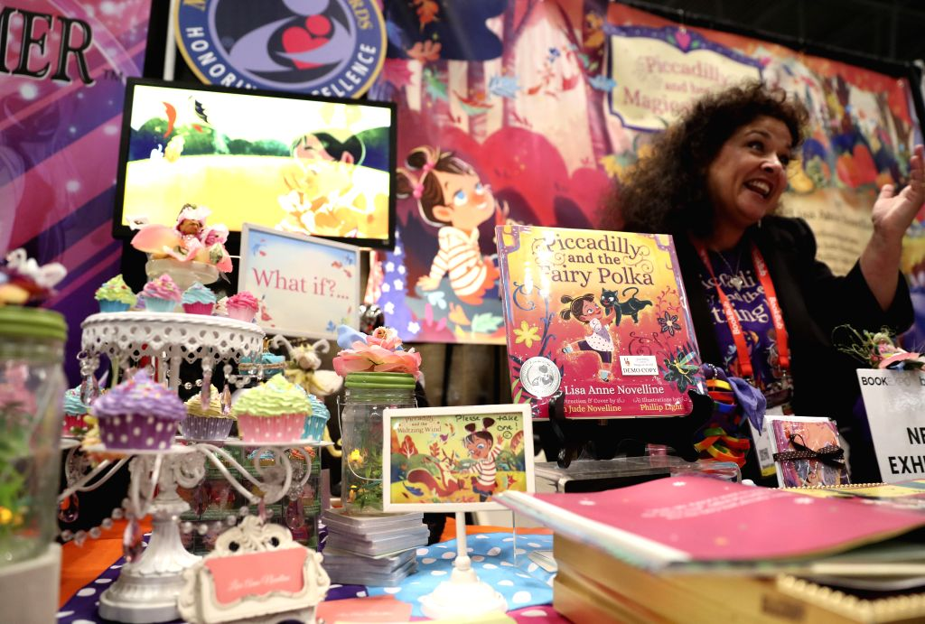 NEW YORK, June 2, 2017 - Lisa Anne Novelline, author of Piccadilly and the Fairy Polka, introduces her book at a booth during the BookExpo 2017 in New York, the United States, on June 2, 2017. ...