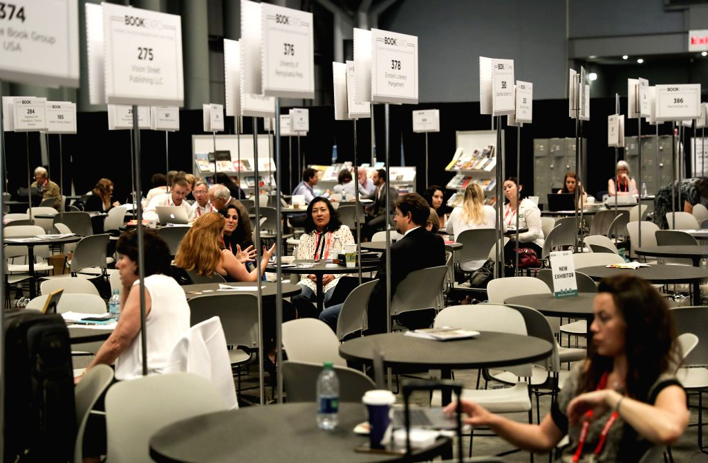 NEW YORK, June 2, 2017 - People work at the international rights center during the BookExpo 2017 in New York, the United States, on June 2, 2017. BookExpo, North America's largest gathering of book ...