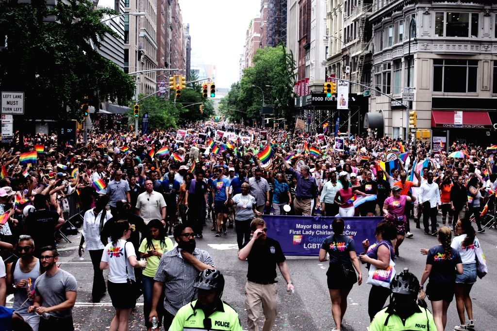 NEW YORK, June 24, 2018 (Xinhua) -- People participate in the 2018 New York City Pride Parade in New York, the United States, on June 24, 2018. (Xinhua/Li Muzi/IANS)