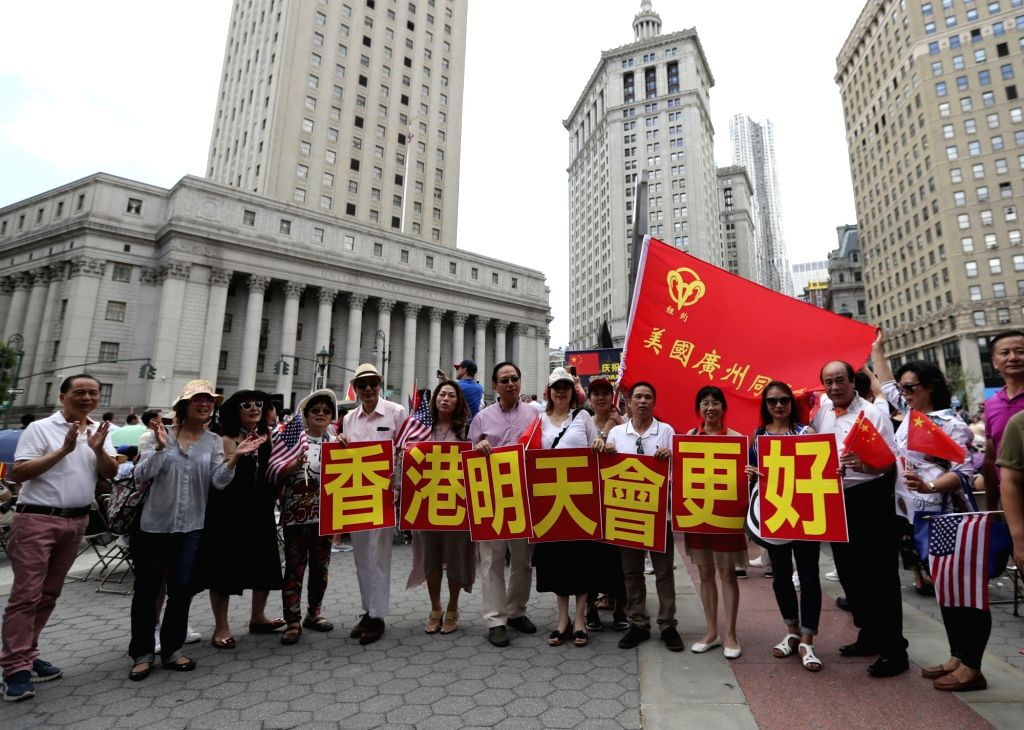 NEW YORK, June 26, 2017 - Participants pose for photos during a rally to celebrate the 20th anniversary of Hong Kong's return to China at the Foley Square in New York, the United States, June 25, ...
