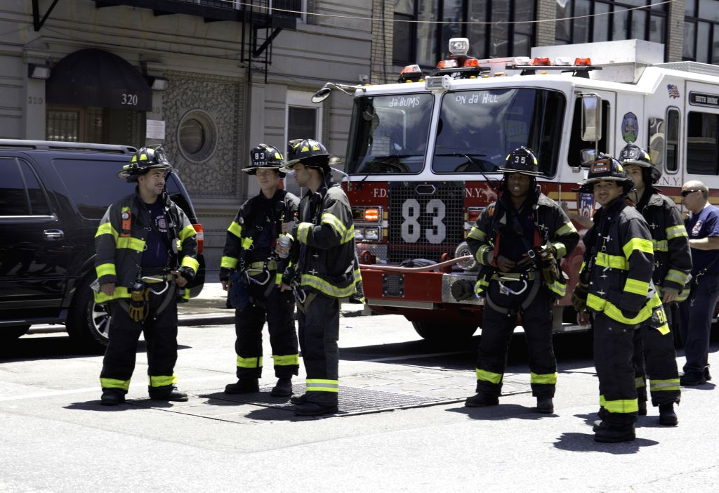 NEW YORK, June 27, 2017 - Rescuers stand by near the site of a subway derailment in Harlem, New York, the United States, on June 27, 2017. At least 34 people were injured from a subway derailment in ...