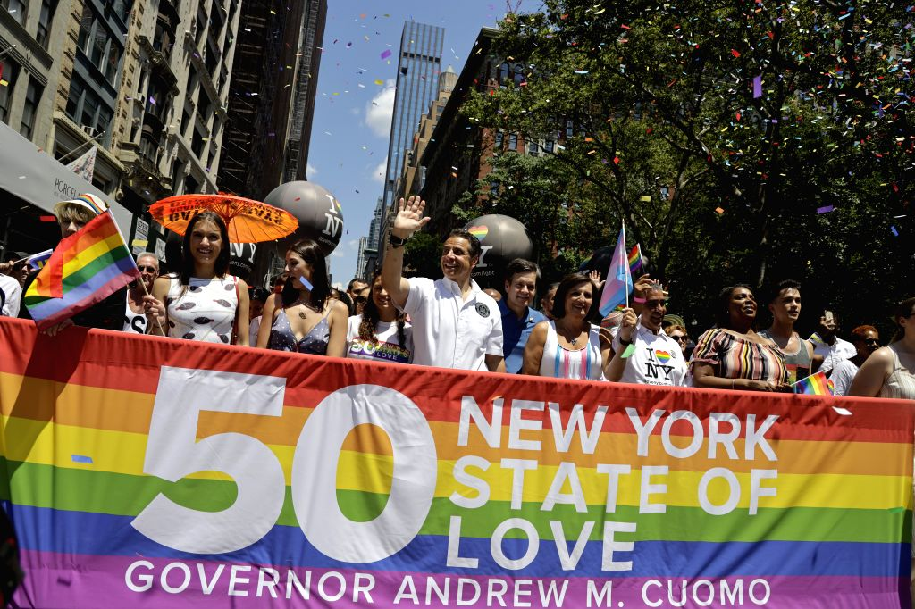 NEW YORK, June 30, 2019 (Xinhua) -- New York State Governor Andrew Cuomo (4th L, front) participates in the 2019 New York City Pride Parade in New York, the United States, on June 30, 2019. Thousands of people took part in the annual Pride celebratio