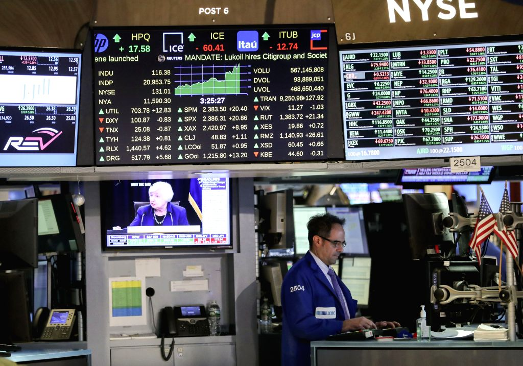 NEW YORK, March 15, 2017 - A trader works at the New York Stock Exchange in New York, the United States, on March 15, 2017. U.S. stocks posted solid gains Wednesday as Wall Street digested the ...