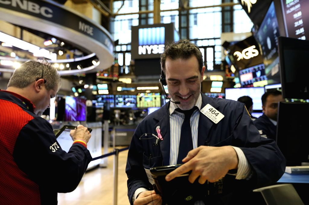 NEW YORK, March 15, 2017 - Traders work at the New York Stock Exchange in New York, the United States, on March 15, 2017. U.S. stocks posted solid gains Wednesday as Wall Street digested the Federal ...