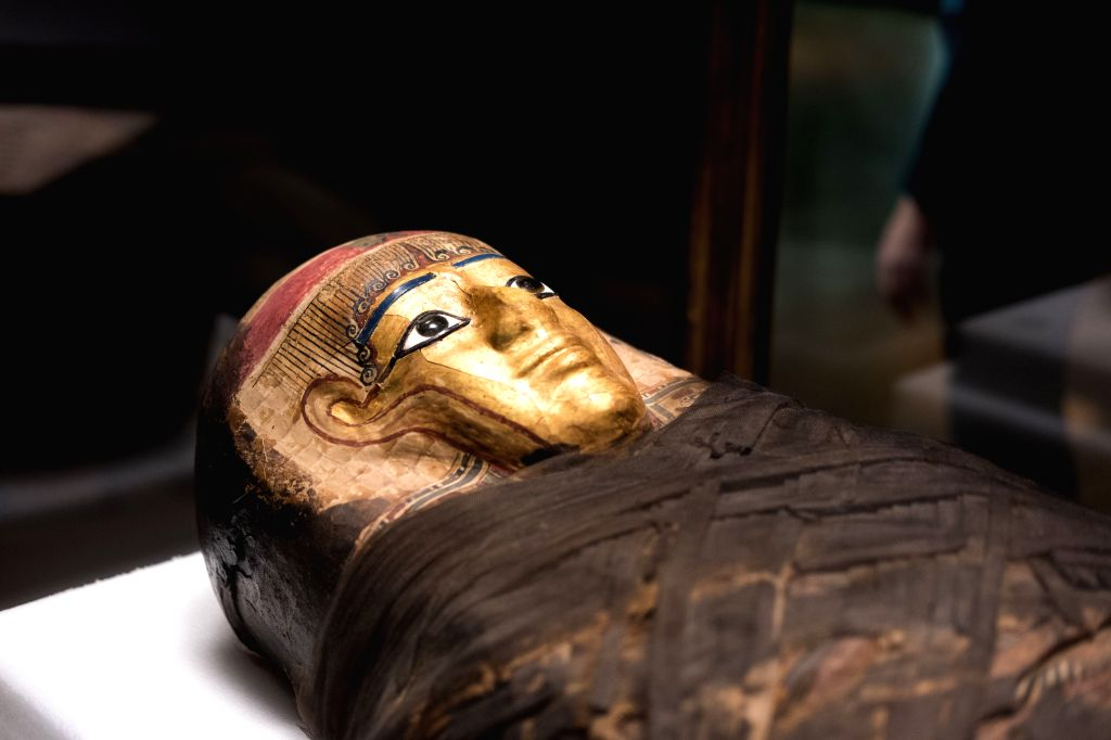 """NEW YORK, March 17, 2017 - A gold-masked coffin named """"Gilded Lady"""" is displayed at the preview of the """"Mummies"""" exhibition at the American Museum of Natural History in New York, ..."""