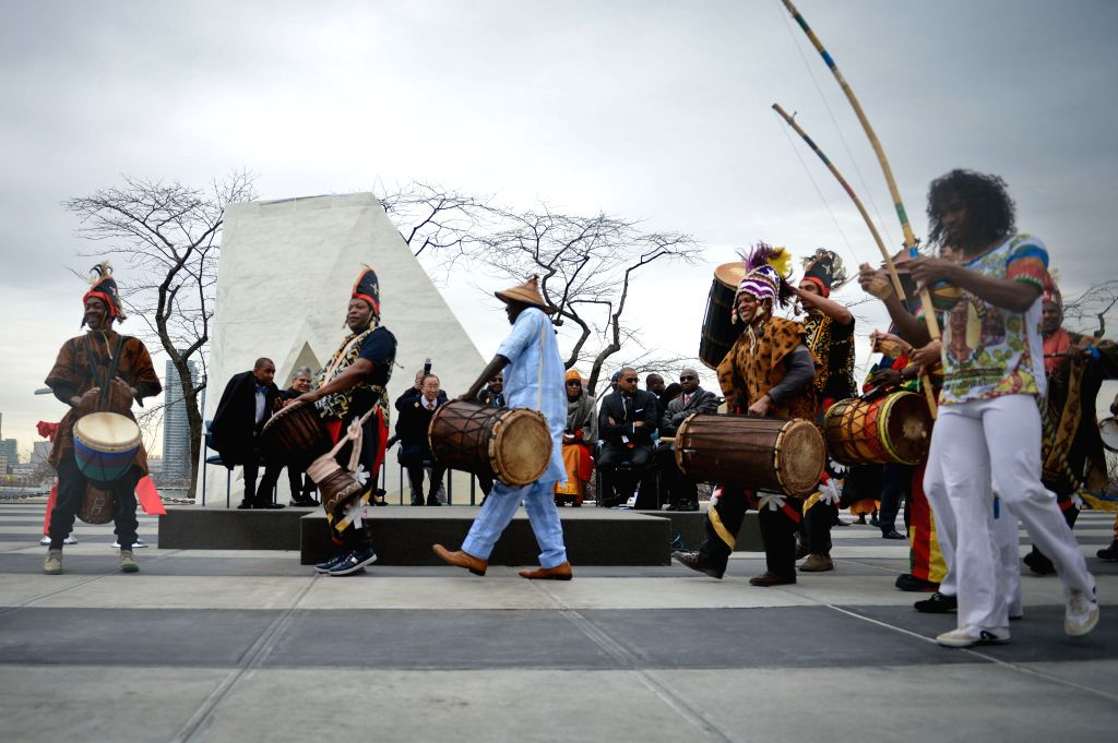 """Artists perform at the end of the unveiling ceremony of a permanent memorial named """"Ark of Return"""" to honour the victims of slavery and the ..."""