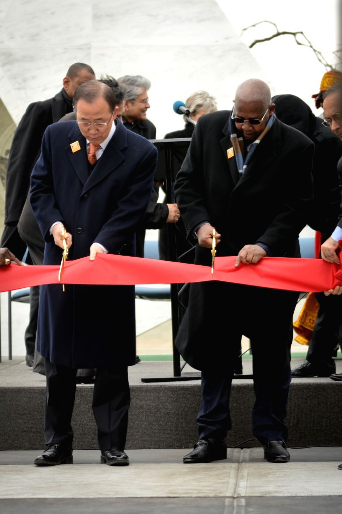 UN Secretary-General Ban Ki-moon (L) and UN General Assembly President Sam Kutesa cut the ribbon during the unveiling ceremony of a permanent memorial named ...