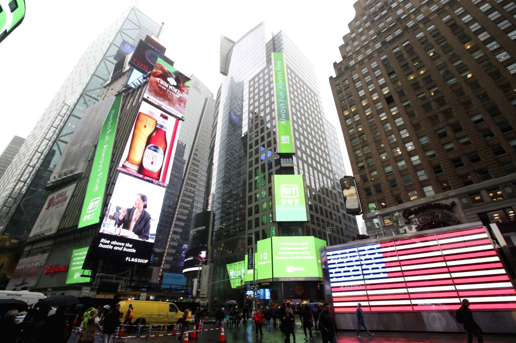 NEW YORK, March 29, 2018 - Advertisements of iQiyi are seen on several screens at Times Square in New York, the United States, on March 29, 2018. Chinese video streaming service iQiyi Inc. rang the ...