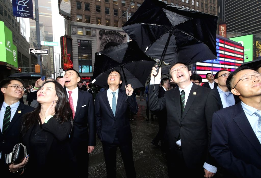 NEW YORK, March 29, 2018 - Li Yanhong (3rd R, Front), chair and CEO of Baidu, and Gong Yu (2nd R, Front), CEO of iQiyi, watch the bell-ringing video outside Nasdaq Marketsite in New York, the United ...