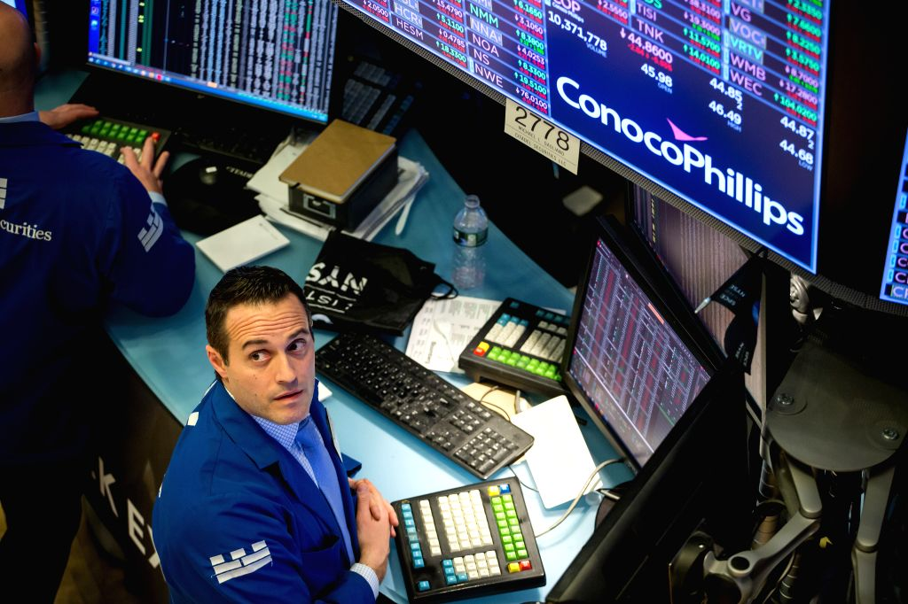 NEW YORK, March 6, 2020 (Xinhua) -- A trader works at the New York Stock Exchange (NYSE) in New York, the United States, on March 6, 2020. U.S. stocks ended lower on Friday. The Dow decreased 0.98 percent to 25,864.78, the S&P 500 dropped 1.71 percen