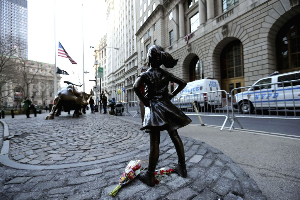 "NEW YORK, March 9, 2017 - Photo taken on March 9, 2017 shows the ""fearless girl"" statue facing the bronze bull statue near the Wall Street in New York, the United States. The ""fearless ..."