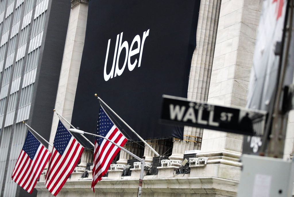 NEW YORK, May 10, 2019 - A banner of Uber Technologies Inc. is seen hanging outside the New York Stock Exchange in New York, the United States, May 10, 2019. U.S. ride hailing company Uber ...