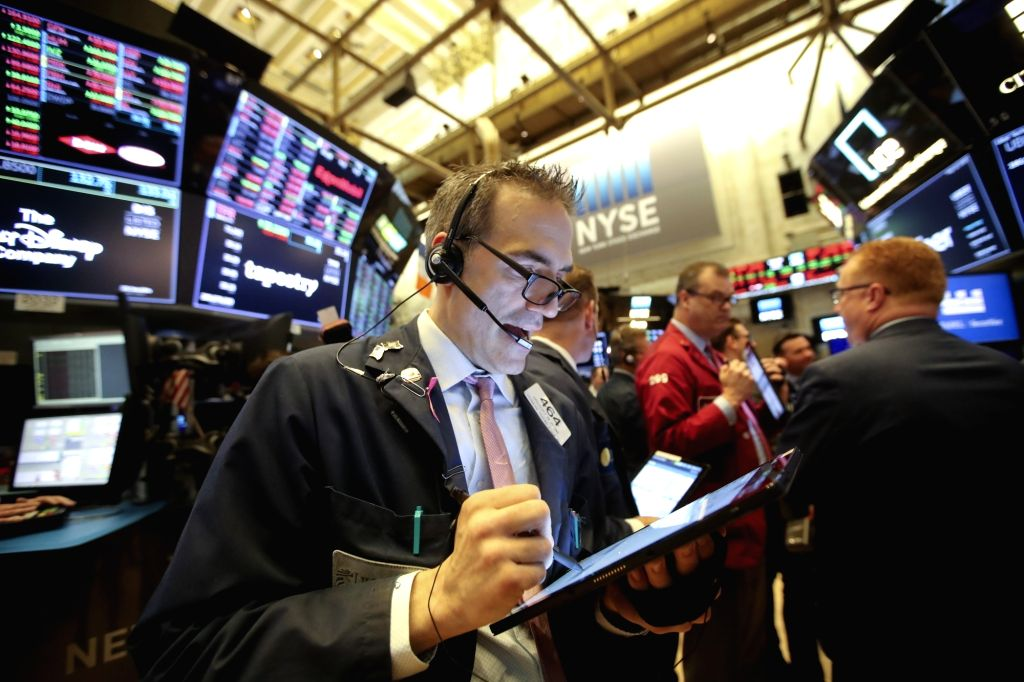 NEW YORK, May 10, 2019 - Traders work at the New York Stock Exchange in New York, the United States, May 10, 2019. U.S. stocks closed higher on Friday. The Dow Jones Industrial Average increased ...