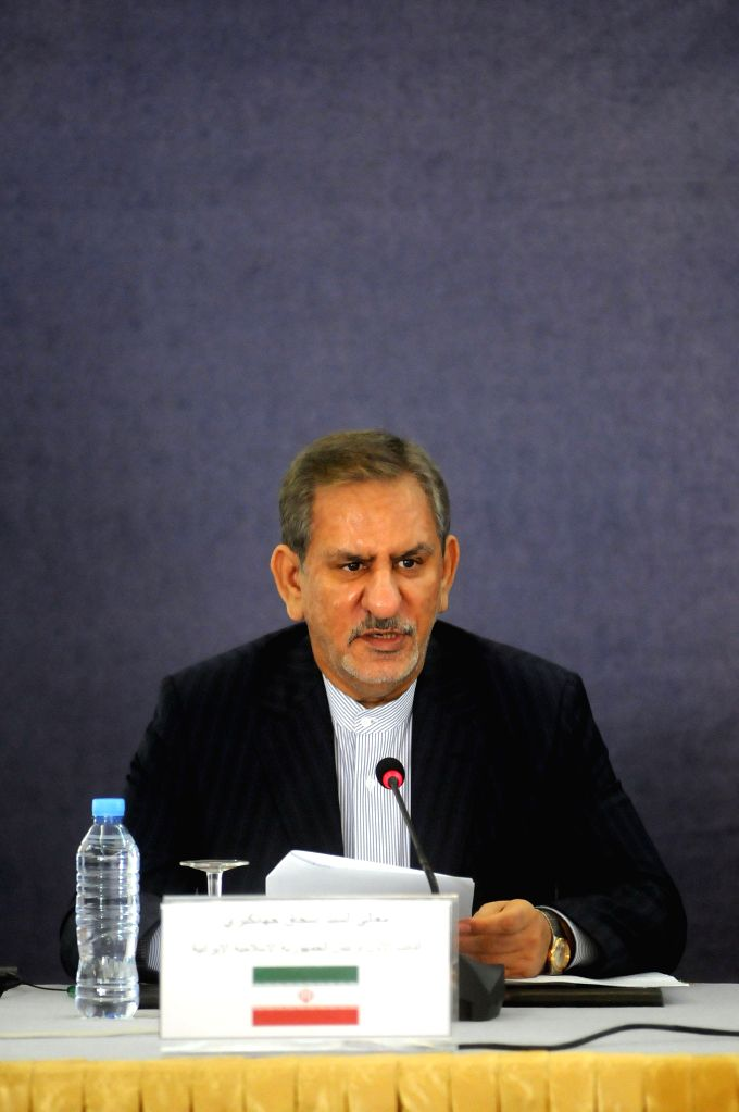 NEW YORK, May 16, 2017 - File photo taken on Dec. 17, 2015 shows visiting Iran's first Vice President Eshaq Jahangiri attending a meeting together with Algerian Prime Minister Abelmalek Sellal (not ... - Abelmalek Sellal and Hassan Rouhani
