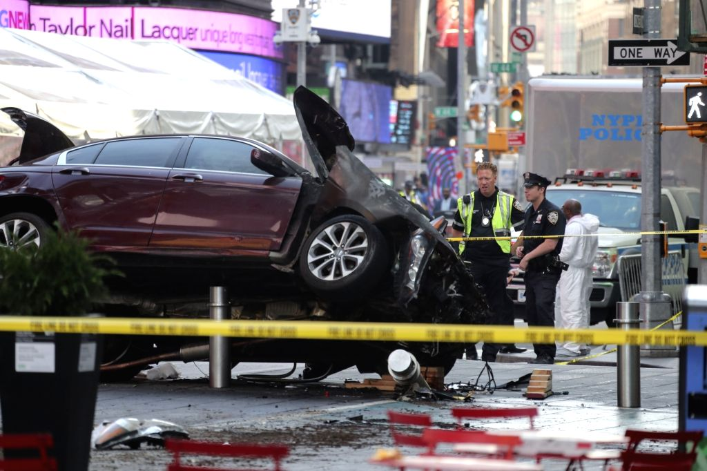NEW YORK, May 18, 2017 - Police officers work on the scene of a car crash incident at Times Square in New York City, the United States, on May 18, 2017. The man who drove a car into a crowd in Times ...