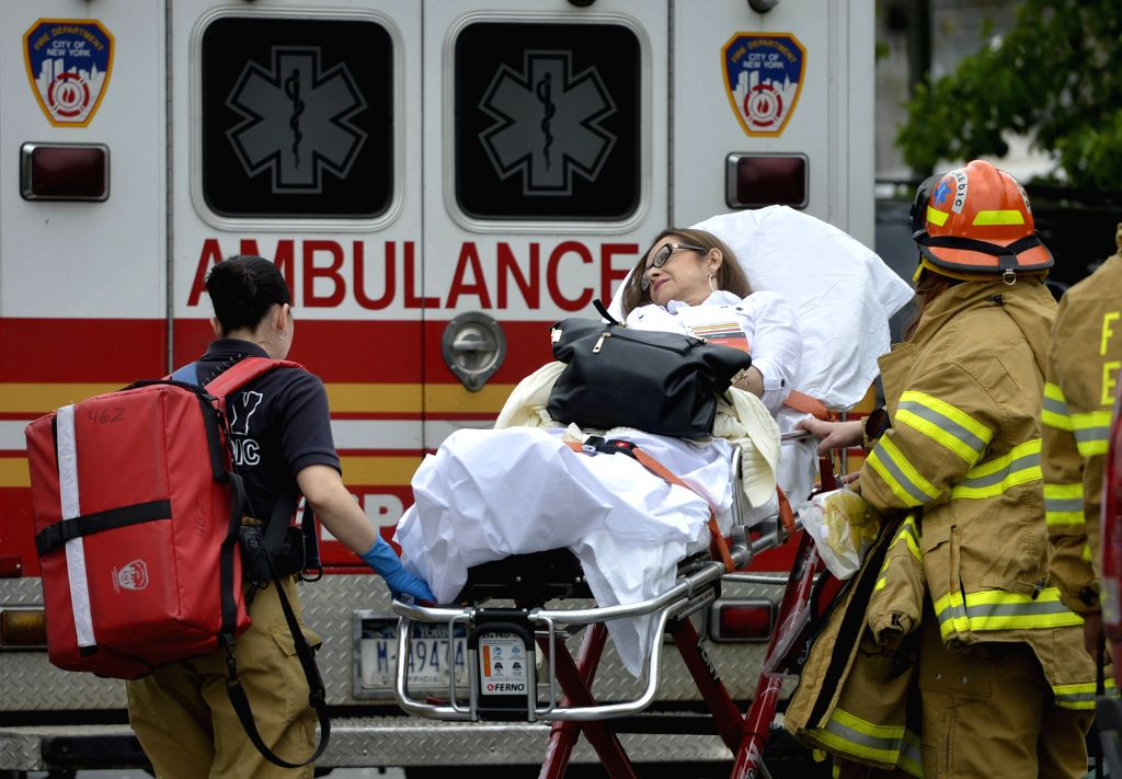An injured person is transported towards an ambulance in the New York City borough of Queens, May 2, 2014. An F train carrying some 1,000 passengers and heading ...