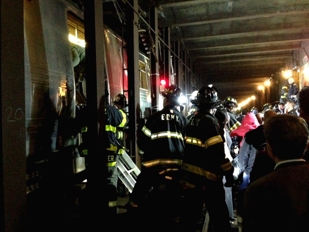 Rescuers evacuate passengers at the site of a subway derailment in the New York City borough of Queens, May 2, 2014. An F train heading Manhattan ran off the tracks .