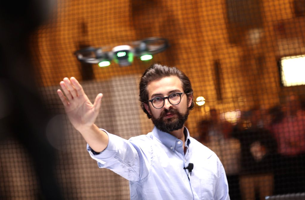 """NEW YORK, May 24, 2017 - Michael Perry, director of strategic partnerships of DJI, demonstrates the palm-sized drone """"Spark"""" during an event in New York, the United States, on May 24, 2017. ..."""
