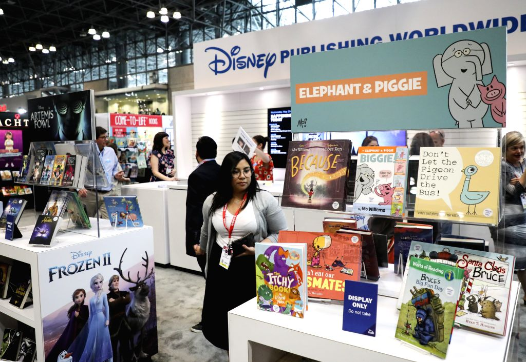 NEW YORK, May 29, 2019 - A visitor looks at books at a booth during the 2019 BookExpo America in New York, the United States, May 29, 2019. BookExpo America, one of the largest in North America, runs ...