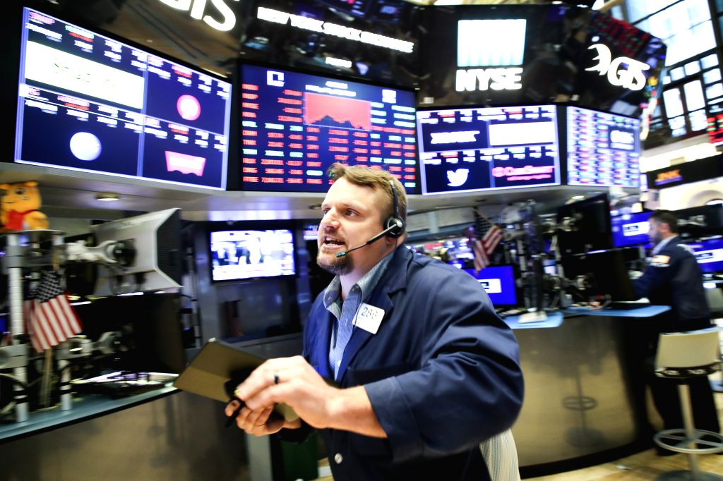 NEW YORK, May 31, 2019 - A trader works at the New York Stock Exchange in New York, the United States, on May 31, 2019. U.S. stocks closed lower on Friday. The Dow Jones Industrial Average fell ...