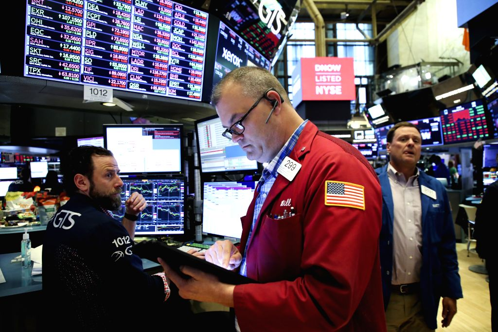 NEW YORK, May 31, 2019 - Traders work at the New York Stock Exchange in New York, the United States, on May 31, 2019. U.S. stocks closed lower on Friday. The Dow Jones Industrial Average fell 354.84 ...
