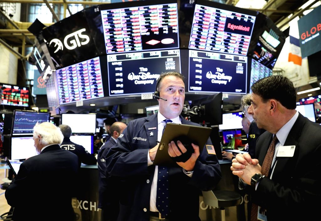 NEW YORK, May 6, 2019 - Traders work at the New York Stock Exchange in New York, the United States, on May 6, 2019. U.S. stocks ended lower on Monday, with the three major indexes all reporting ...
