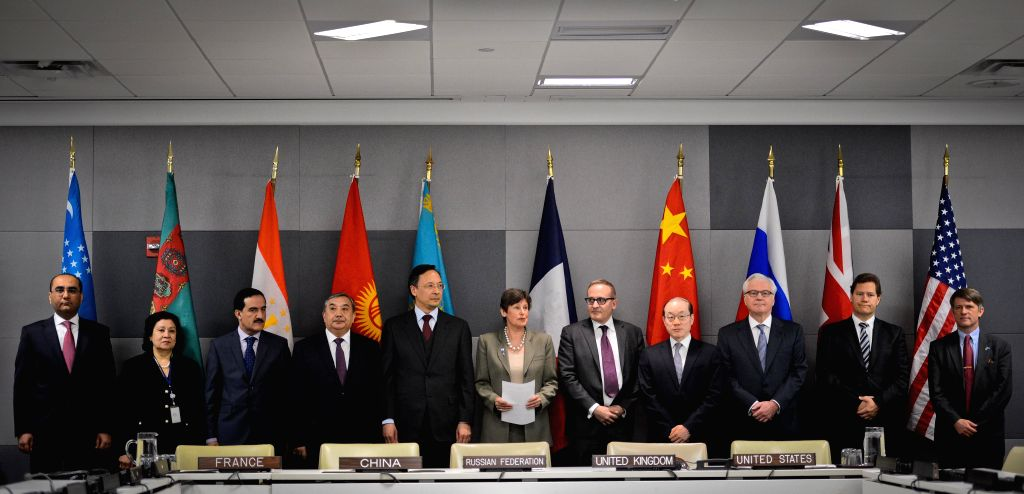 Angela  Kane (C), UN High Representative for Disarmament Affairs, together with representative from the five central Asian countries and representatives of the five .