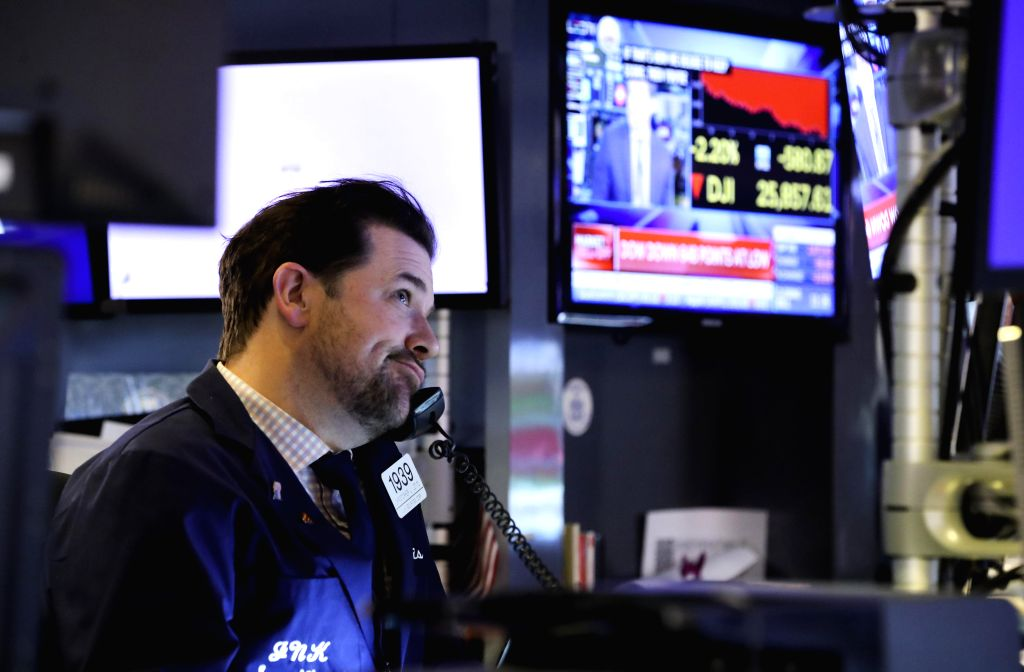 NEW YORK, May 7, 2019 - A trader works at the New York Stock Exchange in New York, the United States, on May 7, 2019. U.S. stocks ended sharply lower on Tuesday. The Dow Jones Industrial Average fell ...
