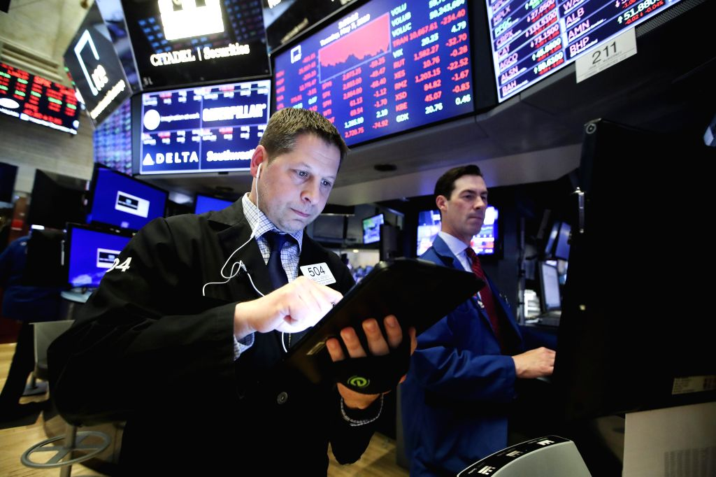 NEW YORK, May 7, 2019 - Traders work at the New York Stock Exchange in New York, the United States, on May 7, 2019. U.S. stocks ended sharply lower on Tuesday. The Dow Jones Industrial Average fell ...