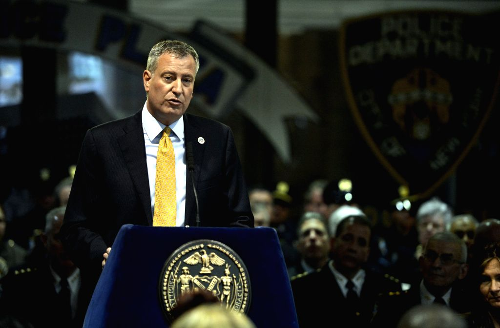 New York City Mayor Bill de Blasio speaks at a memorial ceremony to honor 13 fallen members of the New York City Police Department during 2013, at One Police Plaza ..