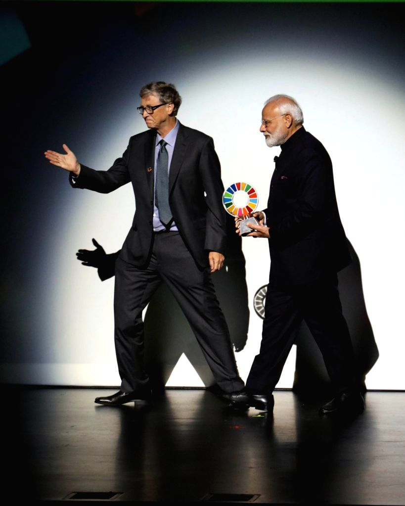 New York: Microsoft founder Bill Gates confers Global Goalkeeper Award on Prime Minister Narendra Modi for the Swachh Bharat mission, in New York on Sep 24, 2019. - Narendra Modi